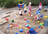 Children playing outside in the sand